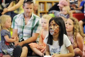 Face painted children sitting