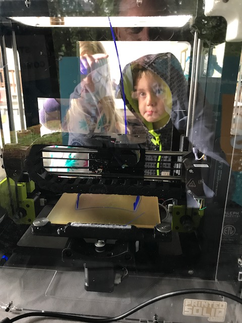 Child watching 3D printer