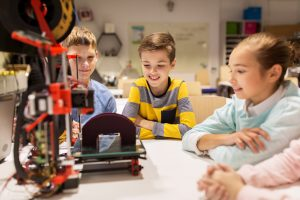 Children playing with 3D printer